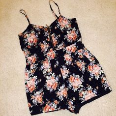Urban Outfitters Zip Front Floral Romper This gorgeous piece is a MUST HAVE for summer! With a shiny gold zipper, beautiful floral pattern throughout, and an elasticized waist who wouldn't want to strut this outfit?! Absolutely stunning romper! Urban Outfitters Other