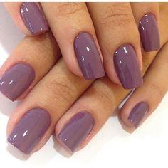 Gorgeous mauve nails.
