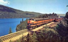"""In this Great Northern publicity photo the eastbound and westbound """"Western Star"""" meet at Whitefish Lake, Montana. Great Northern Railroad, Milwaukee Road, Glacier Park, The Second City, Burlington Northern, Train Pictures, Pacific Northwest, Rocky Mountains, Whitefish"""