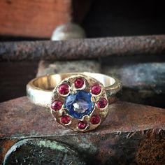 My version of a halo ring. 14k recycled gold snd sapphires.  Made by PhBeads  #handmadejewelry#engagementring#weddingring#weddingrings#jewelrydesigner#goldring#goldjewelry#rusticwedding#recycledgold#handmade#engagementrings#phbeadsjewelry#jewellery#ethicaljewelry#ethicaljewellery#customring#customrings#gemstonering#rusticweddingring#ancient#phbeads#alrernativeengagementring#uniqueengagementring#uniquehalo#sustainablejewelry#sustainabledesign