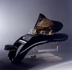 """Oh my!!! """"Isn't that an awesome piano? It's called the Pegasus, and it's made by the Schimmel Piano company in Germany. The modern exterior houses a traditional (as in non-electronic) grand piano. Though """"traditional"""" doesn't normally include a hydraulic lid or ergonomic keys with a slight curve."""""""