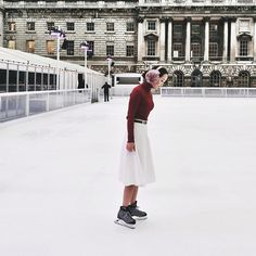 Your Holiday-Outfit-Idea Handbook #refinery29  http://www.refinery29.com/best-holiday-outfits#slide3  Try Winter White On For Size If you're going ice skating this season, but have yet to find the perfect outfit to hit the rink in, Shini Park has you covered. Her white flared midi-skirt and burgundy turtleneck offer plenty of twirl without drawing any figure-skater comparisons.