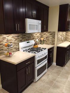 Espresso Kitchen Cabinets with White Appliances.                                                                                                                                                                                 More
