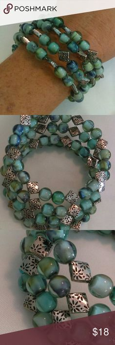 Handmade Green/Blue & Silver Memory Wire Bracelet Handmade memory wire bracelet made with green & blue swirled glass beads and antiqued silver accents. Jewelry Bracelets