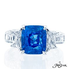"""Style 1423 Platinum sapphire and diamond ring featuring a magnificent 4.91ct """"no-heat"""" cushion sapphire, embraced by princess and trapezoid diamonds."""