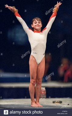 dominique-moceanu-usa-competing-at-the-1995-us-national-championships-C7MT01.jpg (866×1390)