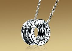 B.ZERO1 pendant in 18kt white gold with pavé diamonds.