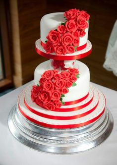 2 tier wedding cake with red sugarpaste roses cascade