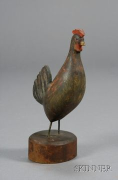Small Carved and Polycrome Painted Wooden Rooster Figure, Enoch Benner (1838-1904), Port Clyde, Maine, c. 1900, the figure with wire legs, mounted on a red-painted round wooden base, overall ht. 7 in. Sold for $ 593
