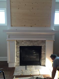 Adding the tile to fireplace by Keith..