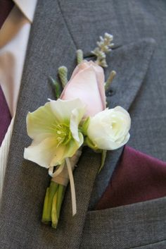 Christmas Rose and Ranuncula Boutonniere