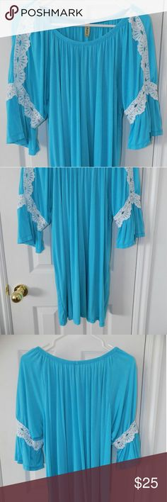 Turquoise Lace Accented Bell Sleeve Tunic 3XL Gorgeous turquoise/teal tunic with white lace. Color is slightly more teal than photo. The bell sleeves are very popular this season! Great condition! La Ropas USA Tops