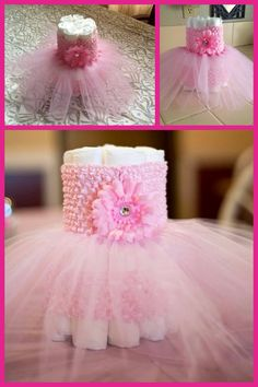 Diaper cake center pieces. Made with headbands from the discount store & pink tule. Using 21 diapers per centerpiece. 7 for the top tier and 14 for the bottom.