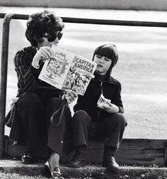 Audrey Hepburn and son, Luca Dotti, reading the Captain America comic in a park, 1975