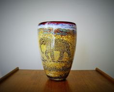 """A Paul Bendzunas Studio Art Glass Elephant Vase Signed Dated Measures 7-1/4"""" tall x 6"""" diameter mouth that terminates to a 1-3/4"""" base diameter"""