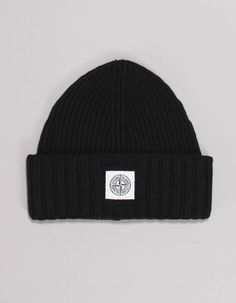This plain black, rib knit beanie hat from Stone Island has folded up trim and features a black square patch to the front with white compass logo detail. The wool mix beanie is machine washable on a cold wash setting. Compass Logo, Stone Island Junior, Bonfire Night, Knit Beanie Hat, Black Square, Plain Black, Folded Up, Black Knit, Rib Knit
