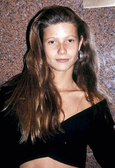 Gwyneth Paltrow in 1989 with sideswept hair and a black crop top