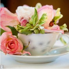 Use Vintage tea cups as mini vases on your tables