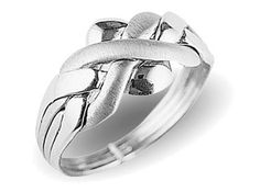 I had a sterling Turkish puzzle ring just like this one as a teenager.  Would love another one!