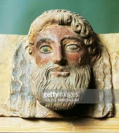 Terracota antefix depicting a bearded man From the temple of Apollo, Thermon-Greece. Arcaeological Museum of Athens.