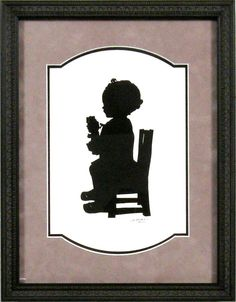 Capture a moment in time of your child with a silhouette! -Bradley's custom framed
