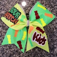 Bows by April - Sour Patch Kids Yellow and Green Neon Glitter Cheer Bow, $25.00 (http://www.bowsbyapril.com/sour-patch-kids-yellow-and-green-neon-glitter-cheer-bow/)