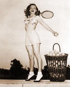 Dec 1947: She a photo session with Nat Dillinger where she was playing tennis.