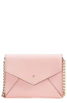 Crushing on the pretty pink shade of this polished Kate Spade envelope-style crossbody bag. So perfect for creating that classic, downtown-chic look.