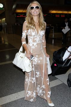 Paris Hilton wears nude For Love and Lemons Elenora maxi dress and white Christian Louboutin pumps.