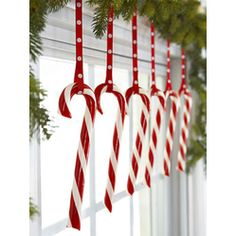 i'm doing this next christmas- in the dining room! Candy Pane Hooked onto polka-dot ribbons, a row of candy canes livens up a bough-decked window. Read more: Red and White Christmas Decorations - Red Christmas Decorating Ideas - Good Housekeeping Noel Christmas, Merry Little Christmas, Primitive Christmas, Christmas Projects, Winter Christmas, Holiday Crafts, Holiday Fun, Christmas Windows, Christmas Candy