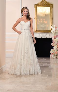 This tulle over matte-side Lustre satin designer wedding dress from Stella York features a gathered sweetheart neckline and corded lace detailing throughout. A glamorous Diamante-beaded belt slims the waist, while the back zips up with ease under fabric-covered buttons.