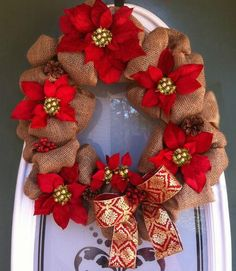 Poinsettias put you in the mood for the holiday season. Create a unique and festive holiday DIY decoration this Christmas with this Poinsettia Burlap Wreath. This creative craft is easy to make and is a unique item to add to your decor this winter.