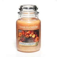 Pumpkin Wreath Scented Candle : The irresistible aroma of fall pumpkins, infused with earthy oakwood, hearty cinnamon bark, and clove, warmly welcomes the season, too. This nature-inspired scent contains apple, resinous spice, and wood notes that play beautifully off the true-to-life pumpkin fragrance.