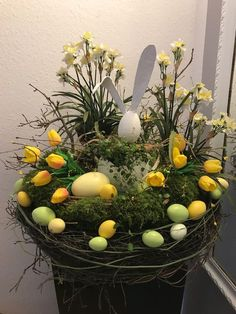 Learn how to make Handmade Dollar Store Easter Decorations on a Budget - Bird Nests! These are the perfect spring decorations that will brighten up your home! Diy Christmas Decorations, Easter Table Decorations, Spring Decorations, Easter Flower Arrangements, Easter Flowers, Deco Floral, Arte Floral, Easter Wreaths, Holiday Wreaths