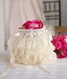 Ruffled Wedding Bag Free Crochet Pattern with lace ruffles. Skill Level: Intermediate Girls of all ages will love this adorable ruffled bag—perfect for a flower girl's petals or to carry small necessities for the bride and bridesmaids. This lace yarn is available in a range of shades, so you're sure to find one that will work with your outfit. Materials: RED HEART® With Love®: 1 skein 1101 Eggshell A RED HEART® Boutique Sassy Lace®: 1 hank 9001 Vanilla B Susan Bates® Crochet Hook: 6mm  Yarn…