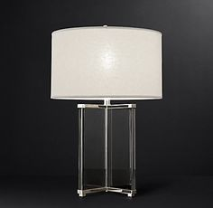 RH Modern's Lawrence Table Lamp:Crystal panels framed in polished metal form the X-shaped base of our Lawrence lamp. Channeling the glamour and drama of 1970s design, the bold form finds cool counterpoint in the soft contours of a white fabric shade.