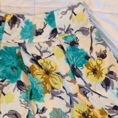 NWOT• FLORAL SKIRT NWOT • blue yellow and gray floral a line skirt with wide waistline. Even features pockets!!! Side zipper. European size 40. United Colors Of Benetton Skirts