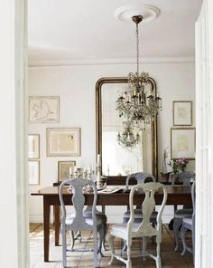 Mixed chairs. old mirror chandelier
