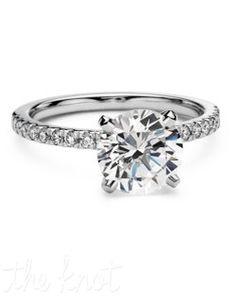 Petite Pavé Diamond Engagement Ring Delicate and beautiful, this diamond engagement ring in 18k white gold features a half circle of sparkling petite pavé diamonds to complement your choice of center diamond.