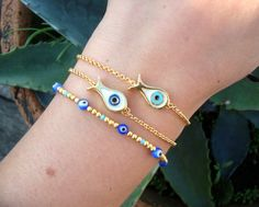 Hey, I found this really awesome Etsy listing at http://www.etsy.com/listing/117859972/gold-chain-evil-eye-bead-fish-bracelet