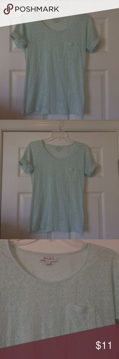 "Banana Republic sheer patterned top Banana Republic short sleeve, crew neck top. Cuffed sleeves. Aqua sheer print pattern (see pic of hand underneath). One small pocket on chest. 50% cotton, 50% polyester. Incredibly soft. Pre-loved but great condition. No stains, etc. L- 23"", W- 15"" Banana Republic Tops"