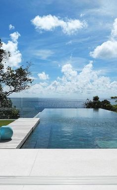 infinity pool with a view would be amazing but if it's too complicated we will stick with a traditional pool.