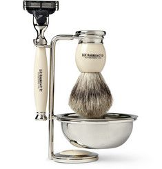 D R Harris Shaving Set: This elegant shaving set comprises a razor that fits a Mach 3 blade, a badger hair brush and chrome stand and bowl. Storing the brush upside down on the stand helps ensure it dries out properly after each use, prolonging its life, while the bowl can be used to work your soap into the perfect lather. Presented in a classic green box with the brand's logo embossed in gold on the top, this makes a stylish gift for the gentleman who prefers the finer things in life.