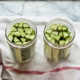Pack the pickles into the jars.