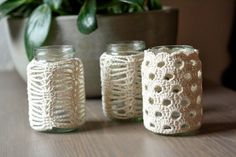 Woolbunnies: Cozy crochet jar candle cozies ~ luv the one with the circle holes!  I think I can read the chart, but it doesn't tell me how many chains to make in the beginning......I'm sure I can figure it out.....:)