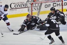 Rush goalie Tim Boron clears the puck