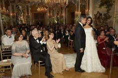 Husband and wife: The guests cheer as Walter Veltroni - the couple's close friend and ex-mayor of Rome - completed the ceremony. Amal's mother Baria and George's parents Nick and Nina sit on the front row