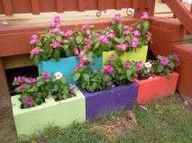 Painted cinder blocks for planters....thanks Sara
