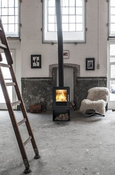Perfect cosiness - with soft fur and lovely warm from the . Wood Burning Fires, Installation Manual, Wood Burner, Side Wall, Steel Doors, Stoves, Pyrography, Scandinavian Design, Glass Door