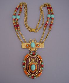 "Lawrence (Larry) Vrba Egyptian pendant necklace with a 25-1/2"" chain with a 5"" by 2-3/4"" pendant. This is in the same style as the Egyptian line he did for Miriam Haskell only larger"